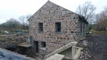 stone work added, old mill with new extensions