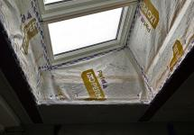 Airtightness materials at roof light on flat roof