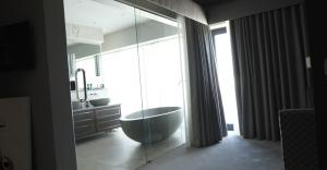 Glass sliding foors from master bed to ensuite